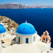 Church Cupolas and the Tower Bell on Santorini - Stock Photo