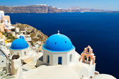 Church Cupolas and the Tower Bell on Santorini — Stock Photo