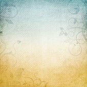 A paper background in beige and blue — Stock Photo