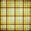 Textile plaid background in green, blue, brown — Stock Photo #11497188