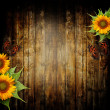 Wooden background with sunflowers and butterfly — Stock Photo #11815748