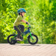 Boy riding bike in a helmet — Stock Photo #11420296