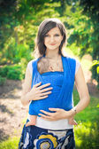 Mother with newborn baby in a sling — Stock Photo