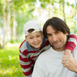 Dad and son at the park during the summer — Stock Photo