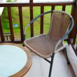 Wicker chair on the balcony — Foto Stock
