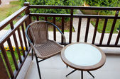 Wicker chair on the balcony — Stock Photo