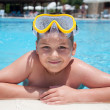 Royalty-Free Stock Photo: Boy with a mask for snorkeling in the pool