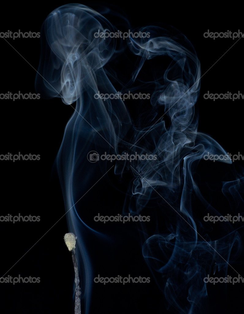 Burnt match in a smoke on a black background. — Stock Photo #12129768