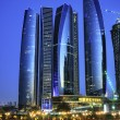Abu Dhabi city by night - Stock Photo