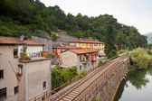 Railway along the river — Stock Photo