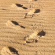 Footprints on a sand — 图库照片