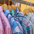 Mix color Shirt and Tie on Hangers , selling — Stock Photo #10965059