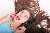 Nice teen girl listening to music with headphones — Stock Photo