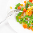 Frozen vegetables and fork on the plate — Stock Photo #11125928