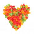 Mix dried colorful fruits candies heart shape isolated on white background — Stock Photo