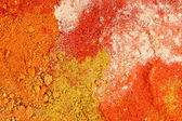 Various colorful spices close up background, - curry, pepper, ginger — Stock Photo