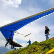 SANTS, SWITZERLAND - May 27: Competitor Ievgen Lysenko from Ukraine of Swiss Masters hang gliding competitions takes part on May 27, 2012 in Sants, Switzerland — стоковое фото #11244521