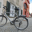 Bicycle on the street of Fussen, town in Bavaria, Germany - Stock Photo