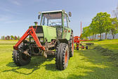 Tractor plows a field in the spring — Stock Photo