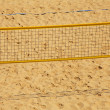 Foto Stock: Volleyball chair and net on beach