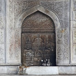 An istanbul mosque  door in Turkey decorated with an intricate arabic style metal grating - Stock Photo