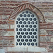Royalty-Free Stock Photo: An istanbul mosque window in Turkey decorated with an intricate arabic style metal grating