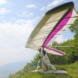 Stock Photo: GEMONA, ITALY- JULY 2012: JuliBurlachenko competes in ItaliOpen-2012 hang gliding competitions at Gemonon July 17, 2012 near Gemona, Italy
