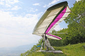 GEMONA, ITALY- JULY 2012: Julia Burlachenko competes in the Italian Open-2012 hang gliding competitions at Gemona on July 17, 2012 near Gemona, Italy — Stock Photo