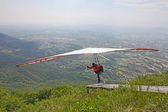 GEMONA, ITALY- JULY 2012: Artem Chervonenko competes in the Italian Open-2012 hang gliding competitions at Gemona on July 17, 2012 near Gemona, Italy — Stock Photo