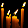 Royalty-Free Stock Photo: Close up view of the candles cutting through the darkness.