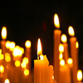 Close up view of the candles cutting through the darkness. — Stok fotoğraf