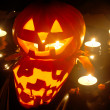 Halloween pumpkin jack-o-lantern candle lit, isolated on black background — Stock Photo