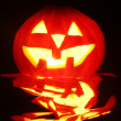 Stock Photo: Halloween pumpkin jack-o-lantern candle lit, isolated on black background
