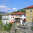 Foto Stock: Beautiful rive Soca and ancient buildings in small town Kanal, Slovenia