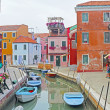 Venice, Burano island canal, small colored houses and the boats — Stock Photo #12361286