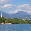 Bled with lake, island, castle and mountains in background, Slovenia, Europe - Stock Photo