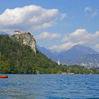 Colorful Bled, with the rock top castle in the background. Slovenia - Stock Photo
