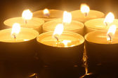 Close up view of the candles cutting through the darkness — Stock Photo