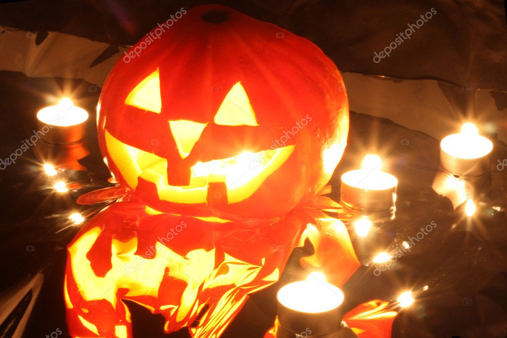 Halloween pumpkin jack-o-lantern candle lit, isolated on black background — Stock Photo #12360678