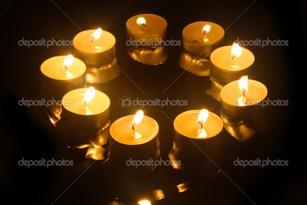 Close up view of the candles cutting through the darkness — Stock Photo #12360695