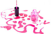 Pink nail polish bottle with splatters isolated on white background — Стоковое фото
