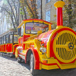 Funny touristic train taken  in the center of Lviv, Ukraine - Stock Photo