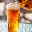 Beer pouring into glass — Stock Photo #12358035
