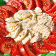 Mozzarella with basil and tomatoes — Stock Photo