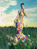 Beautiful lady in dress of flowers — Stock Photo