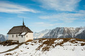 Small church with mountain panorama — Stock Photo
