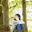 Stock Photo: Ten year old girl sitting quietly in woods