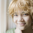 Stockfoto: Biracial young teen girl smiling, closeup