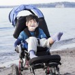 Happy disabled boy in wheelchair on the beach — Foto de Stock