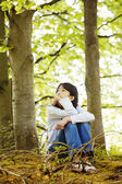 Ten year old girl sitting quietly in woods — Stock Photo